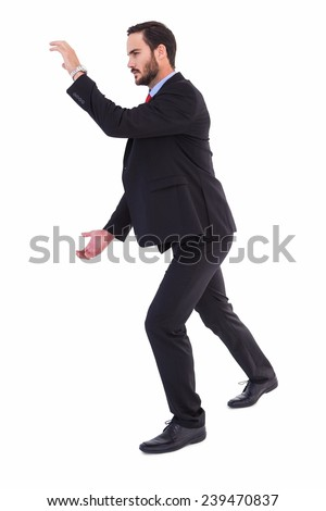 Businessman showing something with his hands on white background - stock photo
