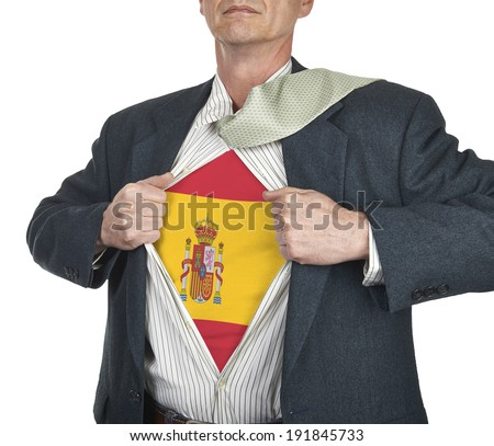 Businessman showing Spain flag superhero suit underneath his shirt standing against white background - stock photo