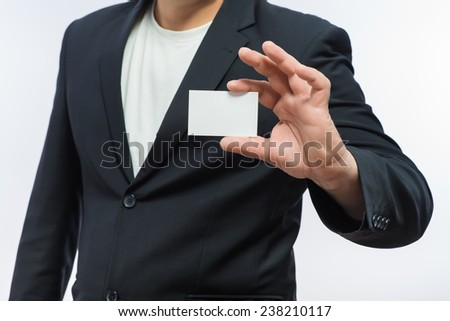 Businessman showing the big blank card in hand - stock photo
