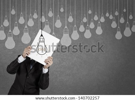 businessman showing the book of drawing idea light bulb concept creative design - stock photo