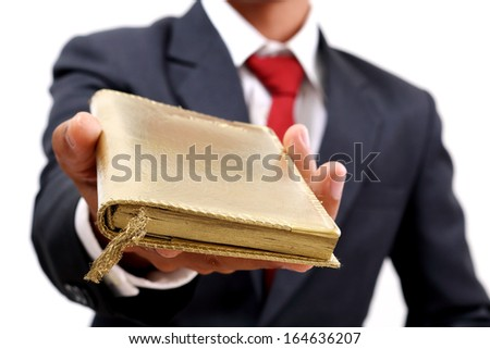 businessman showing the golden book to success - stock photo