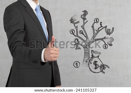 businessman showing thumb up symbol and drawing tree money - stock photo