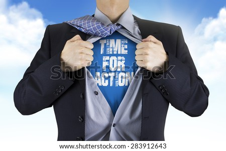 businessman showing Time for action words underneath his shirt over blue sky - stock photo