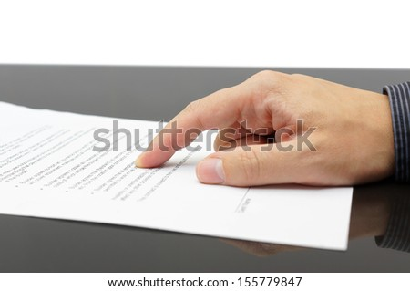 businessman showing Treaty article - stock photo