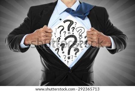 Businessman showing what is in his heart. he is questioning everything. conceptual image of man with curiousity - stock photo