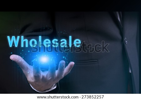 businessman showing wholesale word.marketing concept. - stock photo