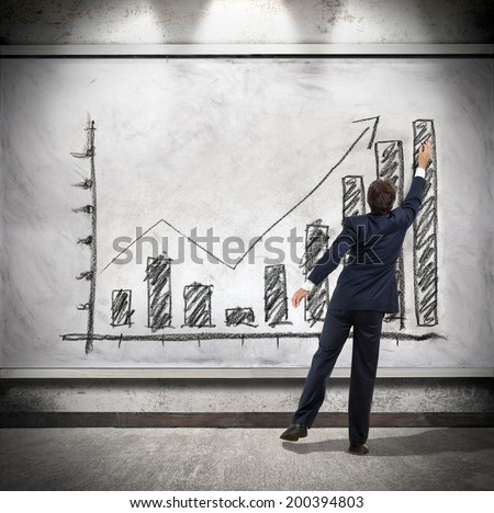 Businessman shows economic growth - stock photo