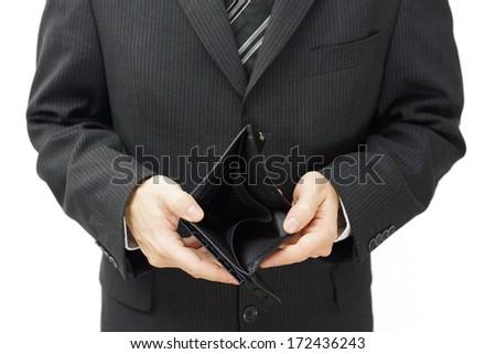 businessman shows empty wallet - stock photo