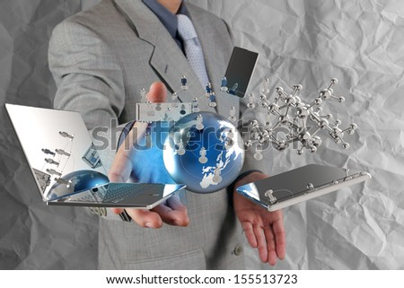businessman shows modern technology with crumpled paper background as concept - stock photo