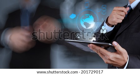 businessman shows modern technology with his team as concept - stock photo