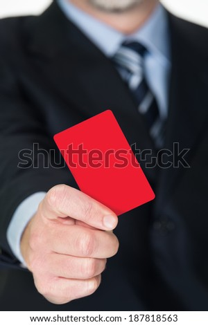 Businessman shows red card - stock photo