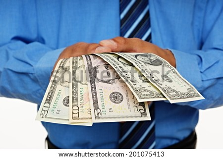 Businessman shows you money, focus is on money - stock photo