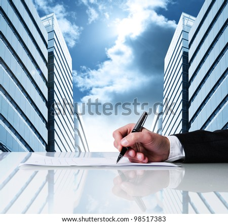 Businessman signing business contract - stock photo