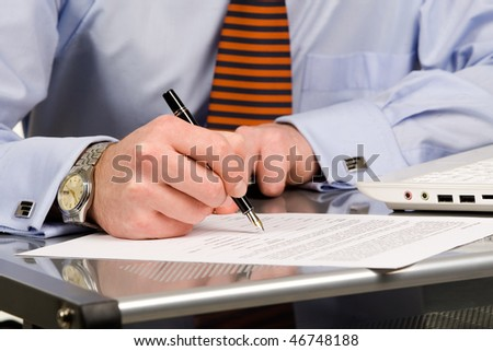 Businessman signing document with pen, isolated - stock photo