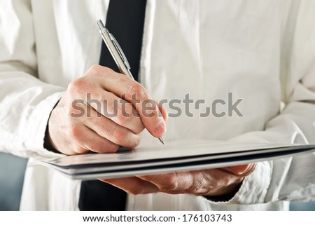 Businessman signing project documentation. Close up image with selective focus. Business situation. - stock photo