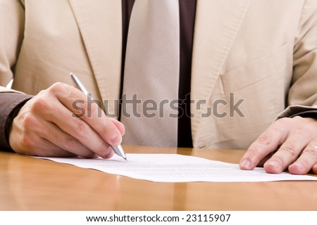 businessman signing some important documents (selective focus) - stock photo
