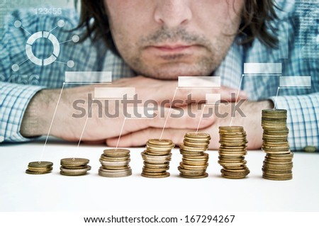 Businessman siting at the table and thinking about possible dollar investments. - stock photo