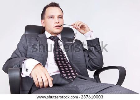 Businessman sitting and thinking - stock photo