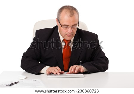 businessman sitting at desk and typing on keyboard with copy scape, isolated on white - stock photo
