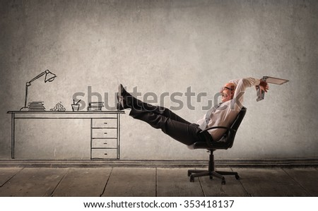 Businessman sitting at his desk - stock photo