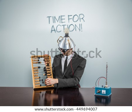 Businessman sitting at office desk with abacus - stock photo