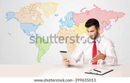 Businessman sitting at white table with colorful world map background - stock photo