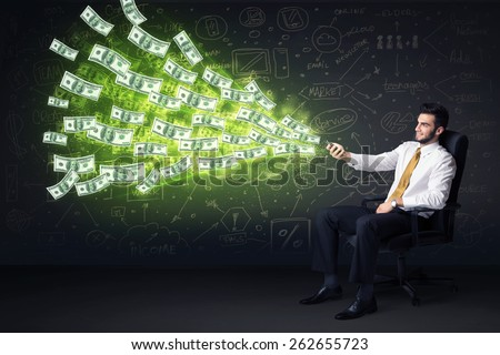 Businessman sitting in chair holding tablet with dollar bills coming out concept on background - stock photo