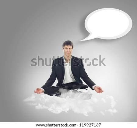 Businessman sitting in lotus position on a cloud - stock photo