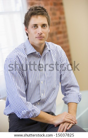 Businessman sitting in office - stock photo