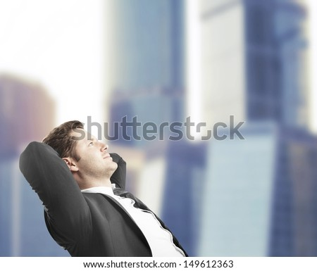 businessman sitting in office and dreaming - stock photo