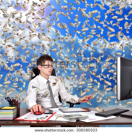 businessman sitting in office and falling dollars banknote on sky background - stock photo