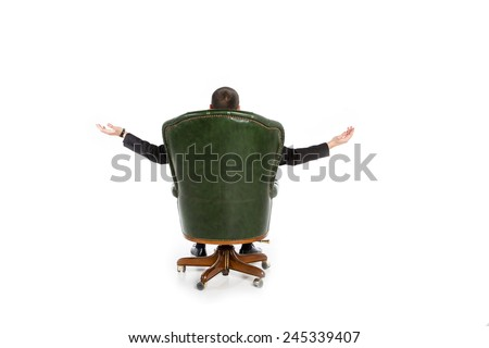 Businessman sitting in the big chair. A man in a chair with his back turned and opened his arms in different directions. Only visible hand of business man. Waiting for the miracle business. - stock photo