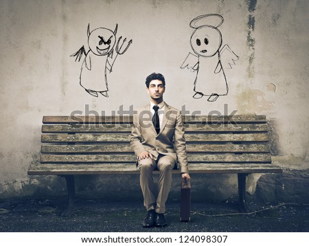 Businessman sitting on a bench with an angel and a devil on his sides - stock photo