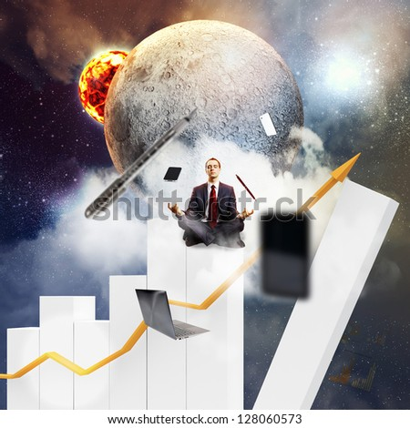 Businessman sitting on bars in lotus flower position against space background with office stuff aloft - stock photo