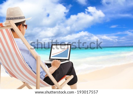 businessman sitting on beach chairs and look stock financial - stock photo