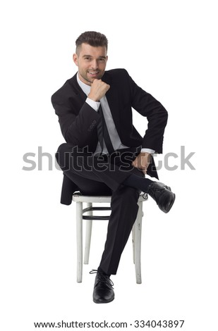 Businessman sitting on chair and thinking Full Length Portrait isolated on White Background - stock photo
