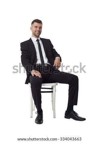 Businessman sitting on chair Full Length Portrait isolated on White Background - stock photo