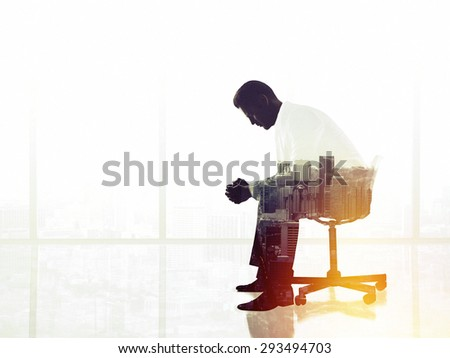 businessman sitting on chair in office, double exposure - stock photo