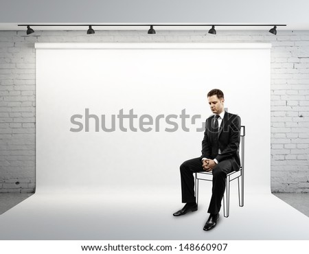 businessman sitting on drawing chair - stock photo