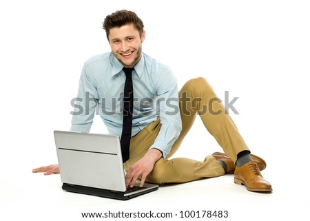 Businessman sitting with laptop - stock photo