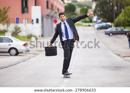 Businessman skateboarding - stock photo