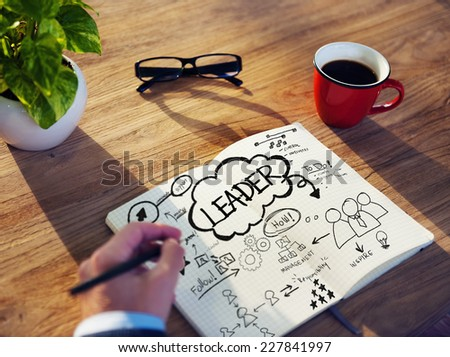 Businessman Sketching About Leadership Concept - stock photo