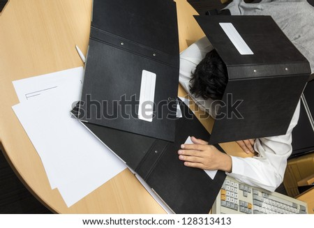 Businessman sleep during working - stock photo