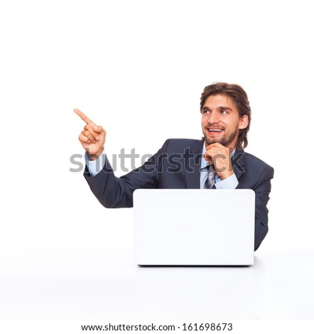 businessman smile point finger side empty copy space, working using laptop computer, handsome young businessman sitting at the desk wear elegant suit, isolated over white background - stock photo