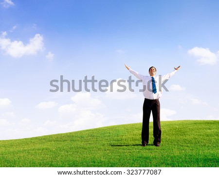Businessman Solitude Relaxation Freedom Success Concept - stock photo