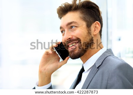 businessman speaking on the phone in office - stock photo