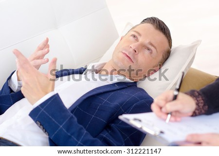 Businessman speaking to a psychologist - stock photo
