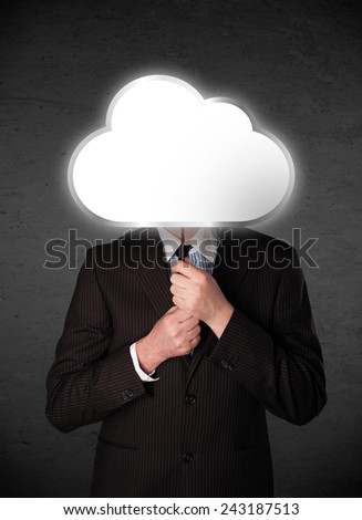 Businessman standing and hiding his head behind an empty cloud - stock photo