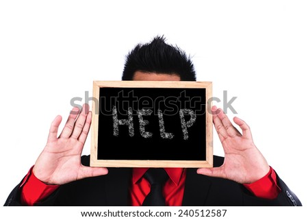 Businessman standing and holding black board with help message - stock photo