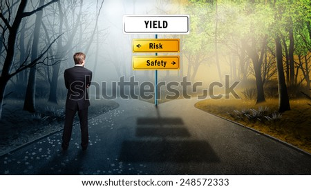 businessman standing at a crossroad to YIELD having the options between risk and safety - stock photo